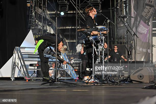 Gustaf Noren and Bjoern Dixgard of Mando Diao perform on stage during the second day of 'Rock am Ring' on June 06 2014 in Nuerburg Germany