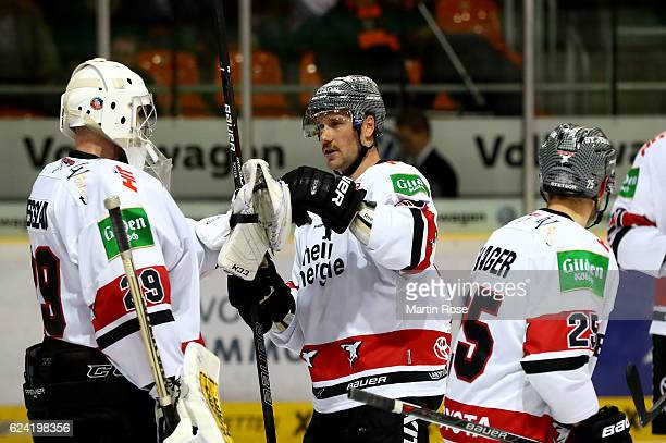 Gustaf Wesslau goaltender of Koeln celebrate with his team mates after the DEL match between Grizzly Wolfsburg and Koelner Haie at BraWo Ice Arena on...