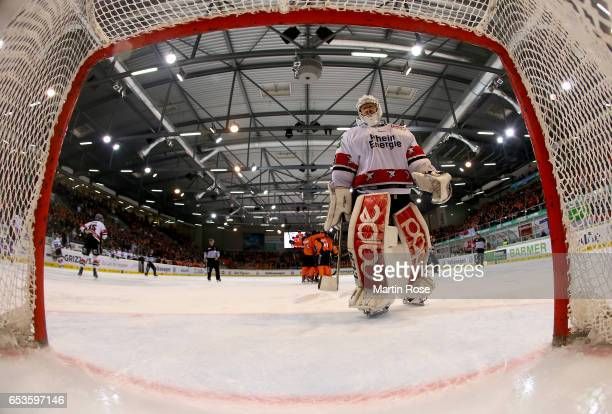 Gustaf Wesslau goaltender of Koeln looks dejected during the DEL Playoffs quarter finals Game 4 between Grizzlya Wolfsburg and Koelner Haie at BraWo...