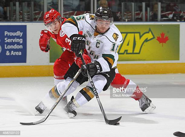 Gustav Bouramman of the Sault Ste Marie Greyhounds tries to check a breaking Max Domi of the London Knights in an OHL game at the Budweiser Gardens...
