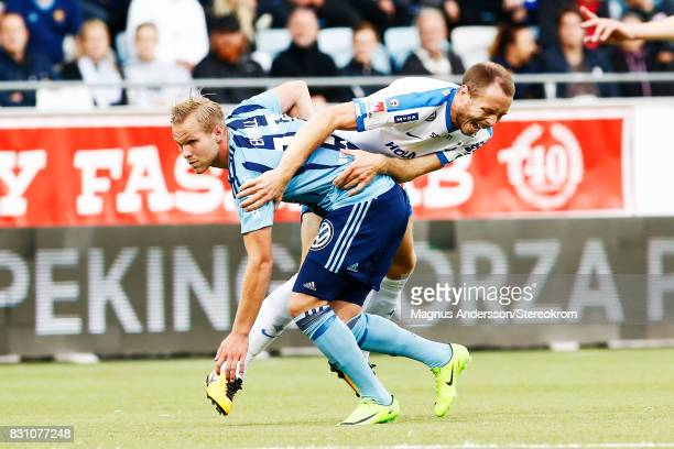 Gustav Engvall of Djurgardens IF and Jon Gudni Fjoluson during the Allsvenskan match between IFK Norrkoping and Djurgardens IF on August 13 2017 in...