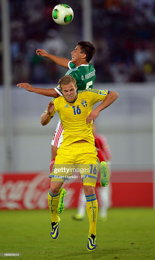 Gustav Engvall of Sweden is challenged by Osvaldo Rodriguez of Mexico during the FIFA U 17 World Cup group F match between Sweden and Mexico at Khalifa Bin Zayed Stadium on October 25, 2013 in Al Ain, United Arab Emirates.