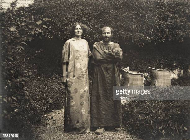 Gustav Klimt and Emilie Floege in a dress with floral pattern in the garden of the Oleander villa in Kammer at the Attersee lake Photography 1910...