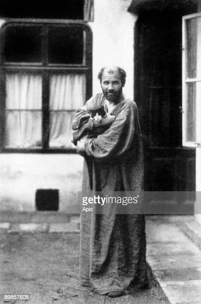 Gustav Klimt austrian painter here in front of his workshop a cat in the arms c 1915