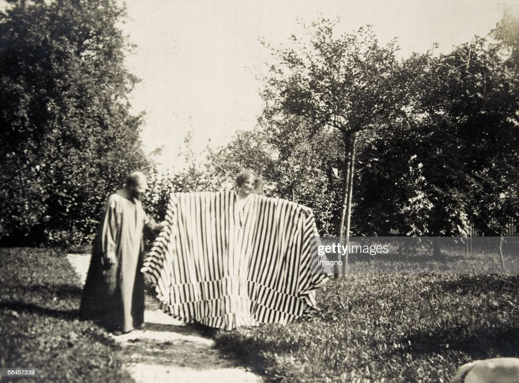 Gustav Klimt, Emilie Floege (in a striped dress, probably by Kolo Moser) with outspread arms and dog. Photography, 1908. (Photo by Imagno/Getty Images) [Gustav Klimt, Emilie Floege (mit Streifen-Kleid vermutlich von Kolo Moser) mit ausgebreiteten Armen und Hund. Photographie, 1908.]