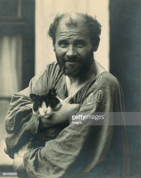 Gustav Klimt in his arms holding one of his cats in front of his studio in Vienna 8th district Josefstaedter Strasse 21 Photography by Moriz Naehr...