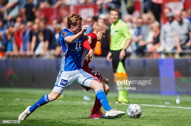 Gustav Marcussen of Lyngby BK and Nicolai Boilesen of FC Copenhagen compete for the ball during the Danish Alka Superliga match between Lyngby BK and...