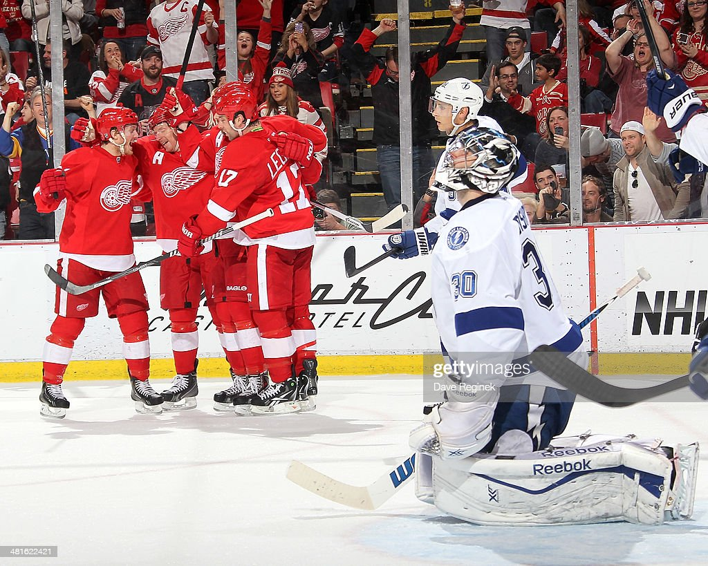 <a gi-track='captionPersonalityLinkClicked' href=/galleries/search?phrase=Gustav+Nyquist&family=editorial&specificpeople=5491209 ng-click='$event.stopPropagation()'>Gustav Nyquist</a> #14, <a gi-track='captionPersonalityLinkClicked' href=/galleries/search?phrase=Daniel+Alfredsson&family=editorial&specificpeople=201853 ng-click='$event.stopPropagation()'>Daniel Alfredsson</a> #11 and <a gi-track='captionPersonalityLinkClicked' href=/galleries/search?phrase=Johan+Franzen&family=editorial&specificpeople=624356 ng-click='$event.stopPropagation()'>Johan Franzen</a> #93 of the Detroit Red Wings congratulate teammate <a gi-track='captionPersonalityLinkClicked' href=/galleries/search?phrase=David+Legwand&family=editorial&specificpeople=202553 ng-click='$event.stopPropagation()'>David Legwand</a> #17 after scoring a goal on <a gi-track='captionPersonalityLinkClicked' href=/galleries/search?phrase=Ben+Bishop&family=editorial&specificpeople=700137 ng-click='$event.stopPropagation()'>Ben Bishop</a> #30 of the Tampa Bay Lightning during an NHL game on March 30, 2014 at Joe Louis Arena in Detroit, Michigan.