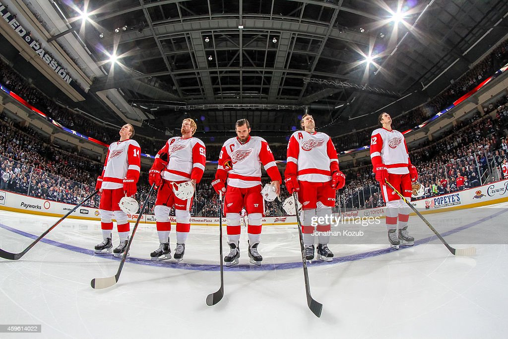 Gustav Nyquist Johan Franzen Henrik Zetterberg Niklas Kronwall and Jonathan Ericsson of the Detroit Red Wings stand on the ice during the singing of...