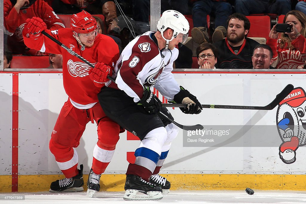 <a gi-track='captionPersonalityLinkClicked' href=/galleries/search?phrase=Gustav+Nyquist&family=editorial&specificpeople=5491209 ng-click='$event.stopPropagation()'>Gustav Nyquist</a> #14 of the Detroit Red Wings and <a gi-track='captionPersonalityLinkClicked' href=/galleries/search?phrase=Jan+Hejda&family=editorial&specificpeople=624333 ng-click='$event.stopPropagation()'>Jan Hejda</a> #8 of the Colorado Avalanche battle for the puck along the boards during an NHL game on March 6, 2014 at Joe Louis Arena in Detroit, Michigan. Colorado defeated Detroit 3-2 in overtime