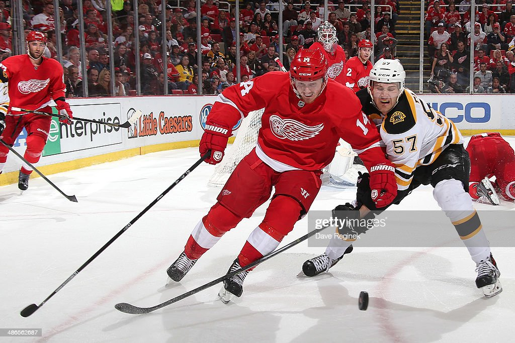<a gi-track='captionPersonalityLinkClicked' href=/galleries/search?phrase=Gustav+Nyquist&family=editorial&specificpeople=5491209 ng-click='$event.stopPropagation()'>Gustav Nyquist</a> #14 of the Detroit Red Wings and Justin Florek #57 of the Boston Bruins battle for the puck during Game Four of the First Round of the 2014 Stanley Cup Playoffs on April 24, 2014 at Joe Louis Arena in Detroit, Michigan.