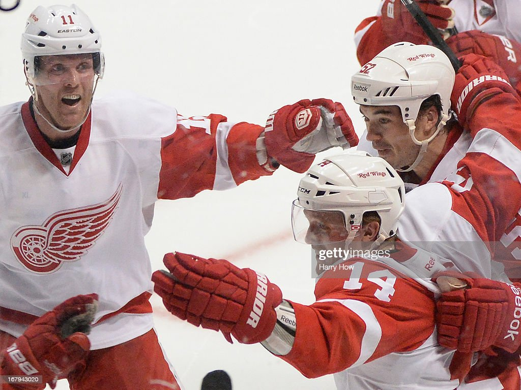 Gustav Nyquist #14 of the Detroit Red Wings celebrates his goal with Daniel Cleary #11 and Jonathan Ericsson #52 to give the the Red Wings a 5-4 overtime win in Game Two of the Western Conference Quarterfinals during the 2013 Stanley Cup Playoffs at Honda Center on May 2, 2013 in Anaheim, California.