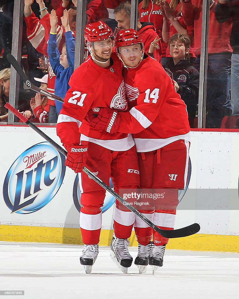 Gustav Nyquist of the Detroit Red Wings celebrates his second goal with teammate Tomas Tatar during an NHL game against the Minnesota Wild on March...