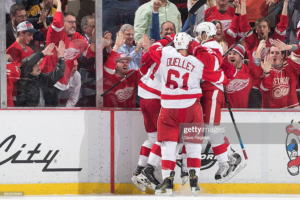Gustav Nyquist #14 of the Detroit Red Wings celebrates his third period goal with teammates Dylan Larkin #71, Tomas Tatar #21 and Xavier Ouellet #61 during an NHL game against the Boston Bruins at Joe Louis Arena on January 18, 2017 in Detroit, Michigan.