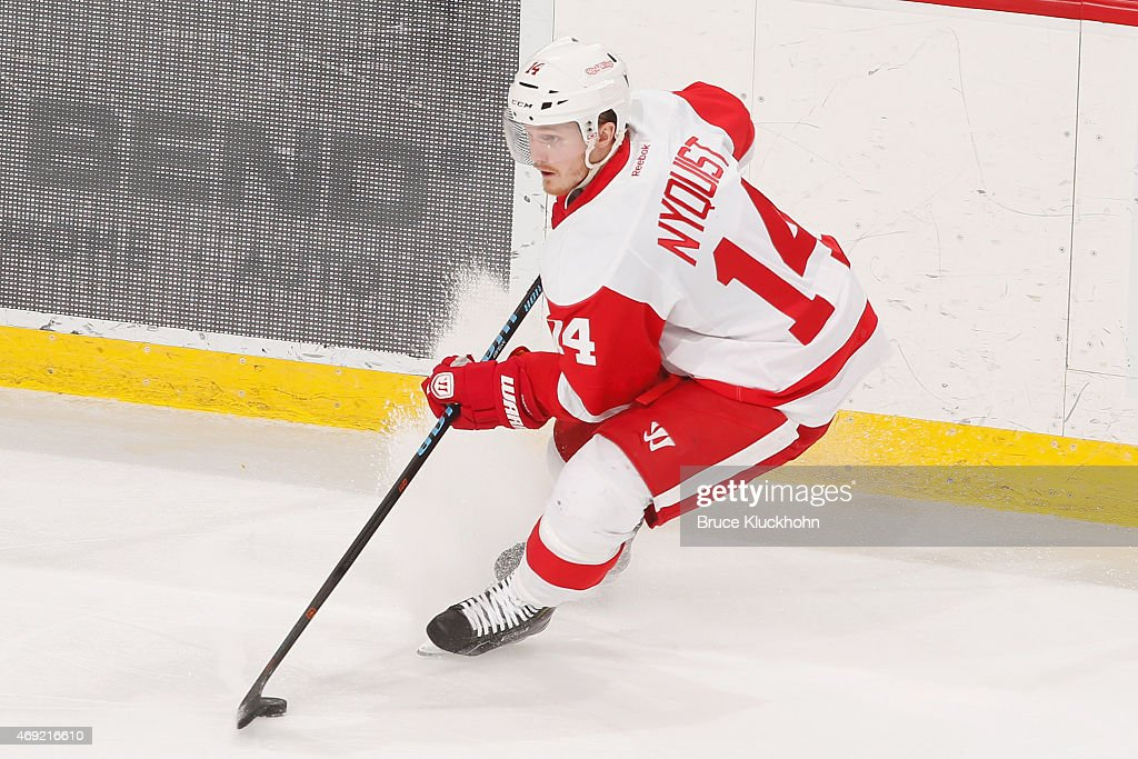 Gustav Nyquist of the Detroit Red Wings handles the puck against the Minnesota Wild during the game at the Xcel Energy Center on April 4 2015 in St...
