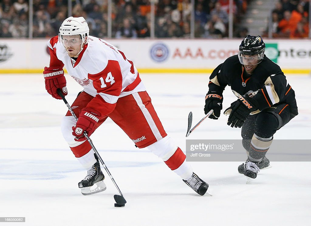 <a gi-track='captionPersonalityLinkClicked' href=/galleries/search?phrase=Gustav+Nyquist&family=editorial&specificpeople=5491209 ng-click='$event.stopPropagation()'>Gustav Nyquist</a> #14 of the Detroit Red Wings is pursued by <a gi-track='captionPersonalityLinkClicked' href=/galleries/search?phrase=Andrew+Cogliano&family=editorial&specificpeople=869296 ng-click='$event.stopPropagation()'>Andrew Cogliano</a> #7 of the Anaheim Ducks for the puck in the second period in Game Five of the Western Conference Quarterfinals during the 2013 NHL Stanley Cup Playoffs at Honda Center on May 8, 2013 in Anaheim, California. The Ducks defeated the Red Wings 3-2 in overtime.