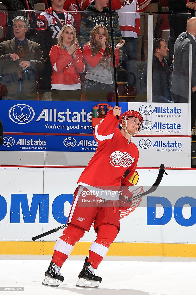 <a gi-track='captionPersonalityLinkClicked' href=/galleries/search?phrase=Gustav+Nyquist&family=editorial&specificpeople=5491209 ng-click='$event.stopPropagation()'>Gustav Nyquist</a> #14 of the Detroit Red Wings salutes the crowd after being named the first star in an NHL game against the Washington Capitals on January 31, 2014 at Joe Louis Arena in Detroit, Michigan. Detroit defeated Washington 4-3 in a shootout.