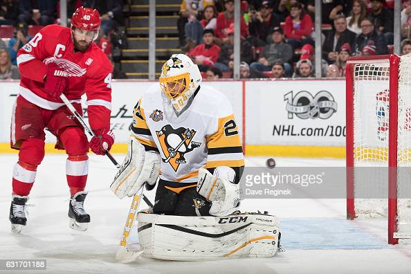 Gustav Nyquist of the Detroit Red Wings scores a goal on MarcAndre Fleury of the Pittsburgh Penguins as Henrik Zetterberg of the Wings posts in front...