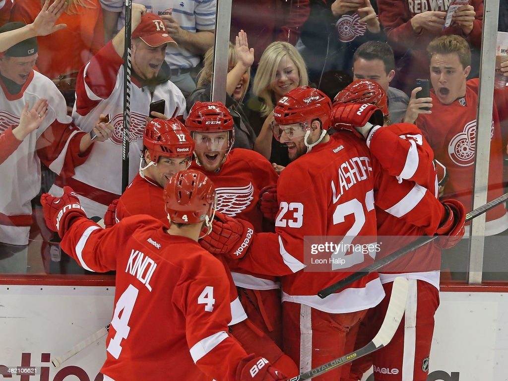 Gustav Nyquist of the Detroit Red Wings scores a third period game winning goal and is congratulated by his teammates during the game against the...