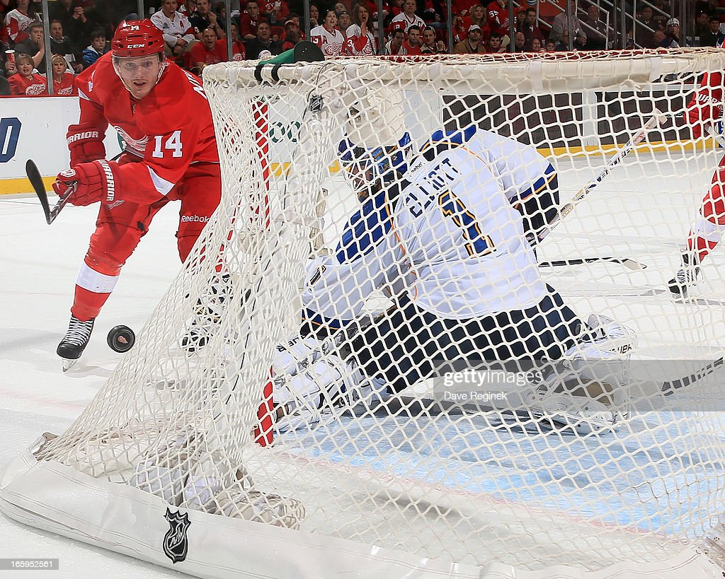Gustav Nyquist #14 of the Detroit Red Wings shoots the puck just wide of goalie <a gi-track='captionPersonalityLinkClicked' href=/galleries/search?phrase=Brian+Elliott&family=editorial&specificpeople=687032 ng-click='$event.stopPropagation()'>Brian Elliott</a> #1 of the St. Louis Blues during a NHL game at Joe Louis Arena on April 7, 2013 in Detroit, Michigan. St. Louis defeated Detroit 1-0