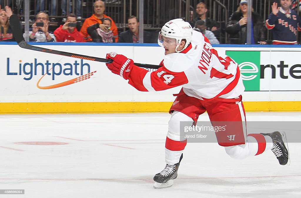 Gustav Nyquist of the Detroit Red Wings shoots the puck on a penalty shot against the New York Rangers at Madison Square Garden on November 5 2014 in...