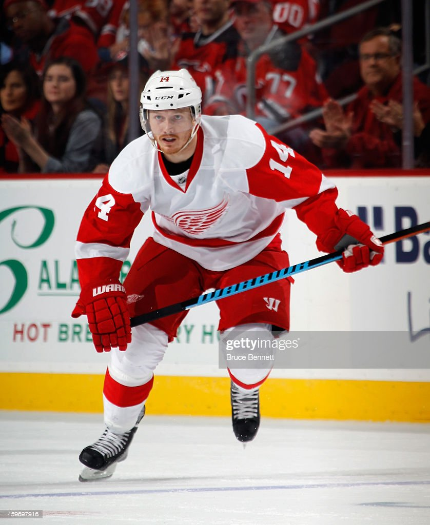 Gustav Nyquist of the Detroit Red Wings skates against the New Jersey Devils at the Prudential Center on November 28 2014 in Newark New Jersey The...