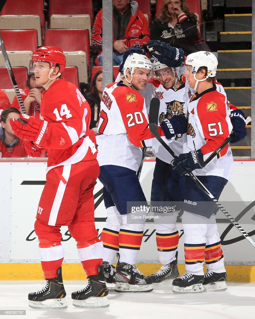 <a gi-track='captionPersonalityLinkClicked' href=/galleries/search?phrase=Gustav+Nyquist&family=editorial&specificpeople=5491209 ng-click='$event.stopPropagation()'>Gustav Nyquist</a> #14 of the Detroit Red Wings skates off the ice as <a gi-track='captionPersonalityLinkClicked' href=/galleries/search?phrase=Sean+Bergenheim&family=editorial&specificpeople=208830 ng-click='$event.stopPropagation()'>Sean Bergenheim</a> #20 and <a gi-track='captionPersonalityLinkClicked' href=/galleries/search?phrase=Brian+Campbell+-+Ice+Hockey+Player&family=editorial&specificpeople=209384 ng-click='$event.stopPropagation()'>Brian Campbell</a> #51 of the Florida Panthers surround teammate <a gi-track='captionPersonalityLinkClicked' href=/galleries/search?phrase=Brad+Boyes&family=editorial&specificpeople=275014 ng-click='$event.stopPropagation()'>Brad Boyes</a> #24 after he scored a short handed goal to tie the score late in the third period during an NHL game on January 26, 2014 at Joe Louis Arena in Detroit, Michigan. Florida defeated Detroit 5-4 in a shootout