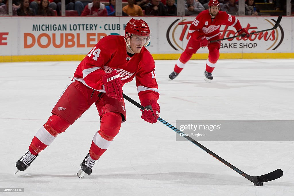 Gustav Nyquist of the Detroit Red Wings skates up ice with the puck during a NHL game against the Tampa Bay Lightning on March 28 2015 at Joe Louis...