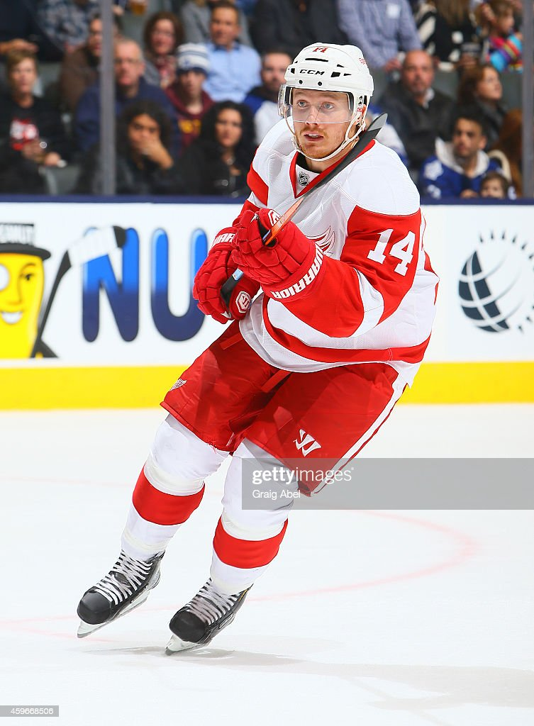 Gustav Nyquist of the Detroit Red Wings skates up the ice during NHL game action against the Toronto Maple Leafs November 22 2014 at the Air Canada...