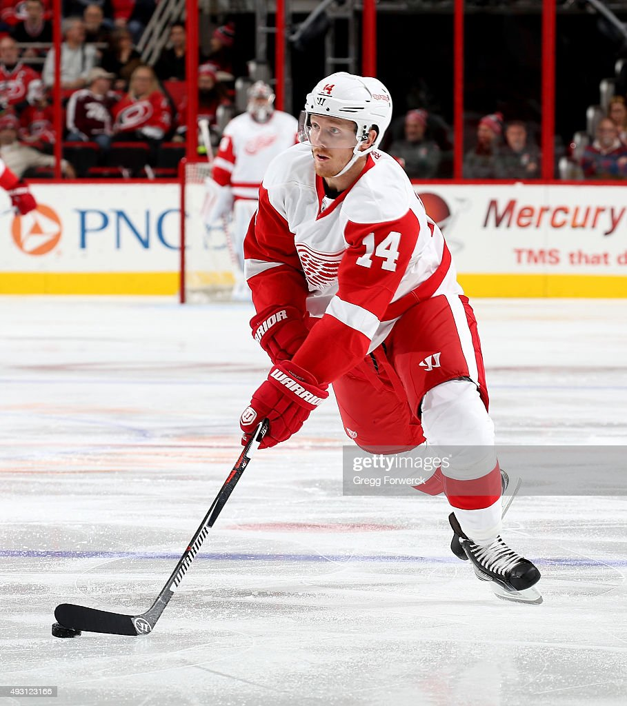 Gustav Nyquist of the Detroit Red Wings skates with the puck during a NHL game against the Carolina Hurricanes at PNC Arena on October 10 2015 in...