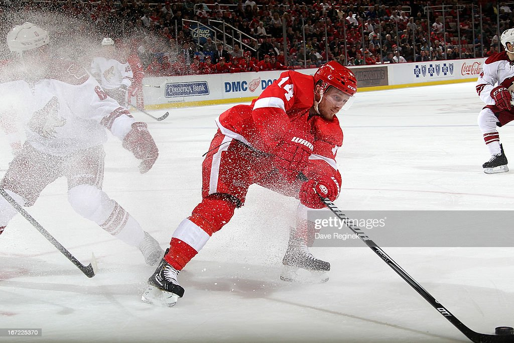 <a gi-track='captionPersonalityLinkClicked' href=/galleries/search?phrase=Gustav+Nyquist&family=editorial&specificpeople=5491209 ng-click='$event.stopPropagation()'>Gustav Nyquist</a> #14 of the Detroit Red Wings spins with the puck away from <a gi-track='captionPersonalityLinkClicked' href=/galleries/search?phrase=David+Schlemko&family=editorial&specificpeople=3144738 ng-click='$event.stopPropagation()'>David Schlemko</a> #6 of the Phoenix Coyotes during a NHL game at Joe Louis Arena on April 22, 2013 in Detroit, Michigan.