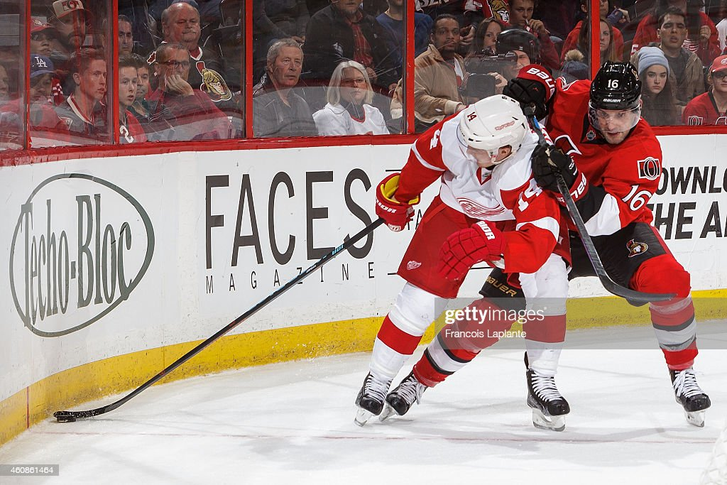 Gustav Nyquist of the Detroit Red Wings stick handles the puck against Clarke MacArthur of the Ottawa Senators at Canadian Tire Centre on December 27...