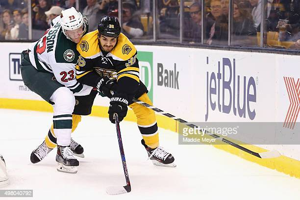 Gustav Olofsson of the Minnesota Wild defends Zac Rinaldo of the Boston Bruins during the first period at TD Garden on November 19 2015 in Boston...