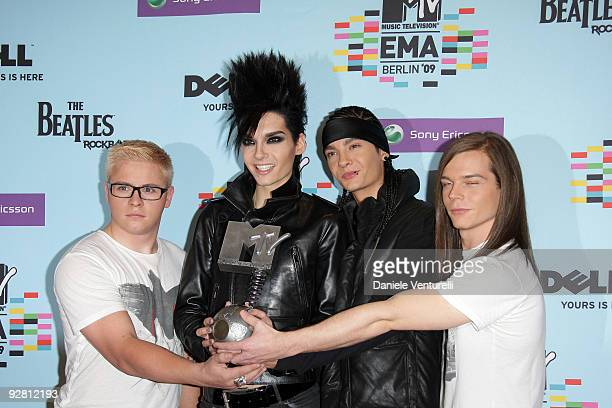 Gustav Schaefer Bill Kaulitz Tom Kaulitz and Georg Listing of Tokio Hotel pose with the award for Best Group at the backstage boards during the 2009...