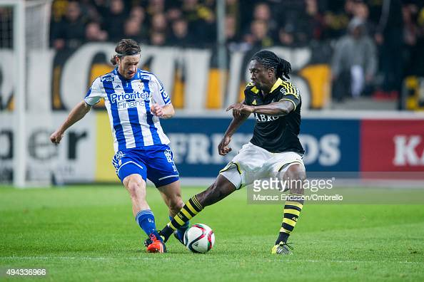 Gustav Svensson of Goteborg and Dickson Etuhu of AIK in action during the Allsvenskan match between AIK and IFK Goteborg at Friends arena on October...