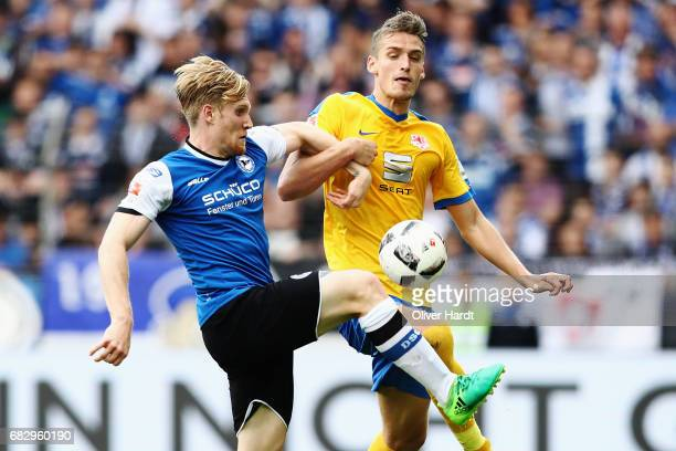 Gustav Valsvik of Braunschweig and Andreas Voglsammer of Bielefeld compete for the ball during the Second Bundesliga match between DSC Arminia...