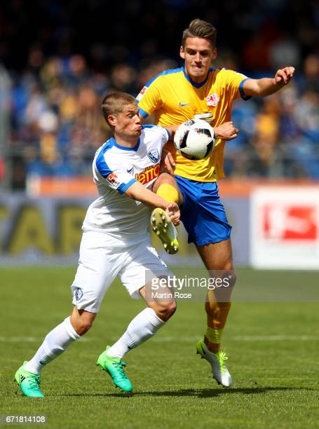 Gustav Valsvik of Braunschweig and Johannes Wurtz of Bochum battle for the ball during the Second Bundesliga match between Eintracht Braunschweig and...