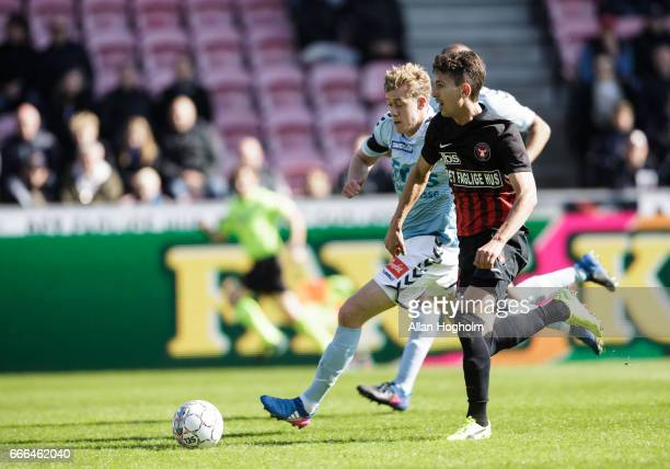 Gustav Wikheim of FC Midtjylland and Christian Jakobsen of SonderjyskE compete for the ball during the Danish Alka Superliga match between FC...