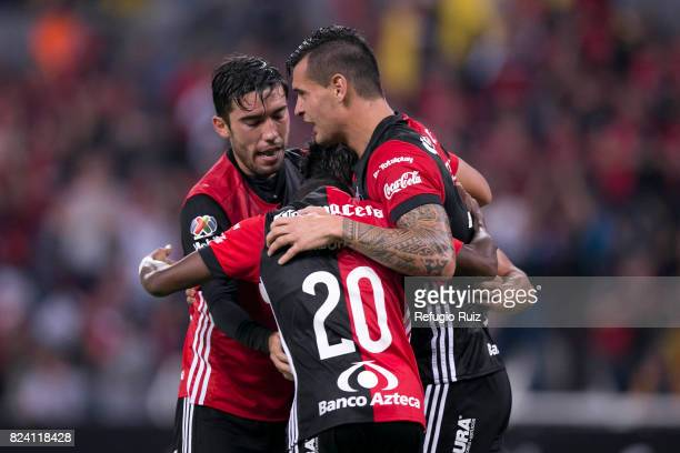 Gustavo Alustiza of Atlas celebrates with teammates after scoring the second goal of his team during the 2nd round match between Atlas and Pumas UNAM...