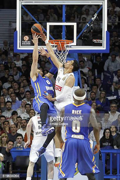 Gustavo Ayon #14 of Real Madrid competes with Josh Boone #6 of Khimki Moscow Region during the 20152016 Turkish Airlines Euroleague Basketball Top 16...