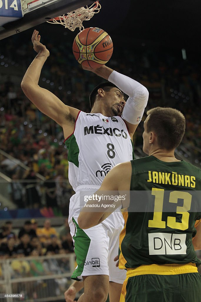Gustavo Ayon (L) of Mexico in action during the 2014 FIBA World basketball championships group D match between Lithuania vs Mexico at the Gran Canaria Arena in Gran Canaria on August 30, 2014.