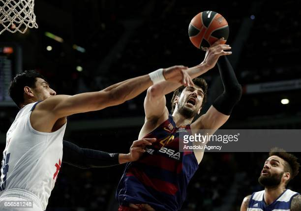 Gustavo Ayon of Real Madrid in action against Ante Tomic of Barcelona Lassa during the Turkish Airlines Euroleague basketball match between Real...