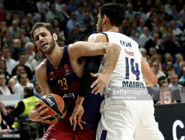 Gustavo Ayon of Real Madrid in action against Stratos Perperoglou of Barcelona Lassa during the Turkish Airlines Euroleague basketball match between...