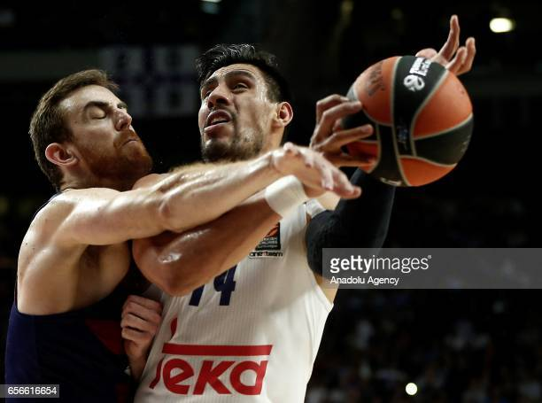 Gustavo Ayon of Real Madrid in action against Victor Claver of Barcelona Lassa during the Turkish Airlines Euroleague basketball match between Real...