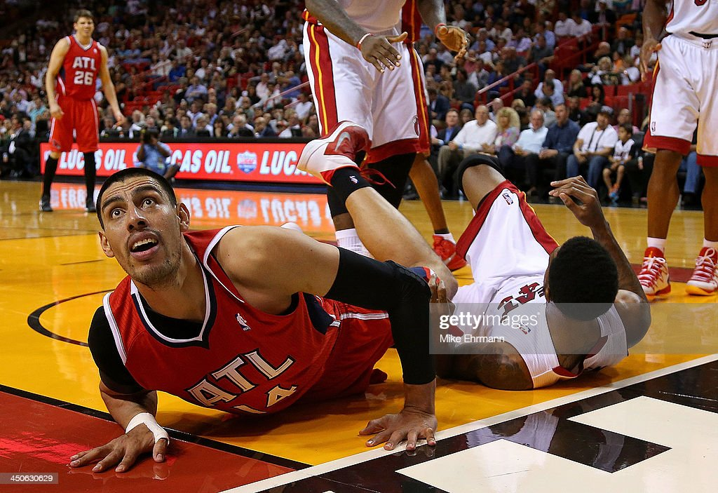 Gustavo Ayon #14 of the Atlanta Hawks looks for a call after fouling Udonis Haslem #40 of the Miami Heat during a game at American Airlines Arena on November 19, 2013 in Miami, Florida.