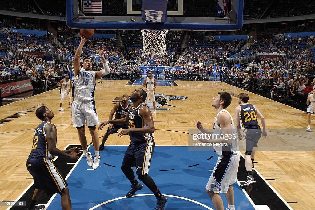 <a gi-track='captionPersonalityLinkClicked' href=/galleries/search?phrase=Gustavo+Ayon&family=editorial&specificpeople=4474343 ng-click='$event.stopPropagation()'>Gustavo Ayon</a> #10 of the Orlando Magic banks one off the glass against the Utah Jazz during the game on December 23, 2012 at Amway Center in Orlando, Florida.