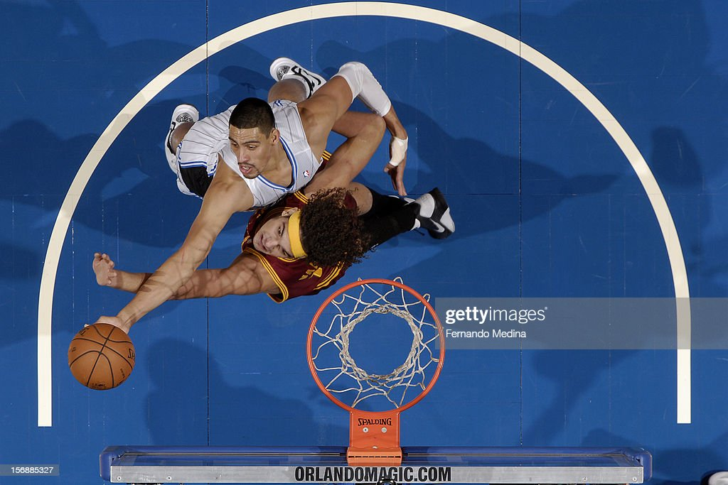 Gustavo Ayon #19 of the Orlando Magic drives to the basket against Anderson Varejao #17 of the Cleveland Cavaliers on November 23, 2012 at Amway Center in Orlando, Florida.