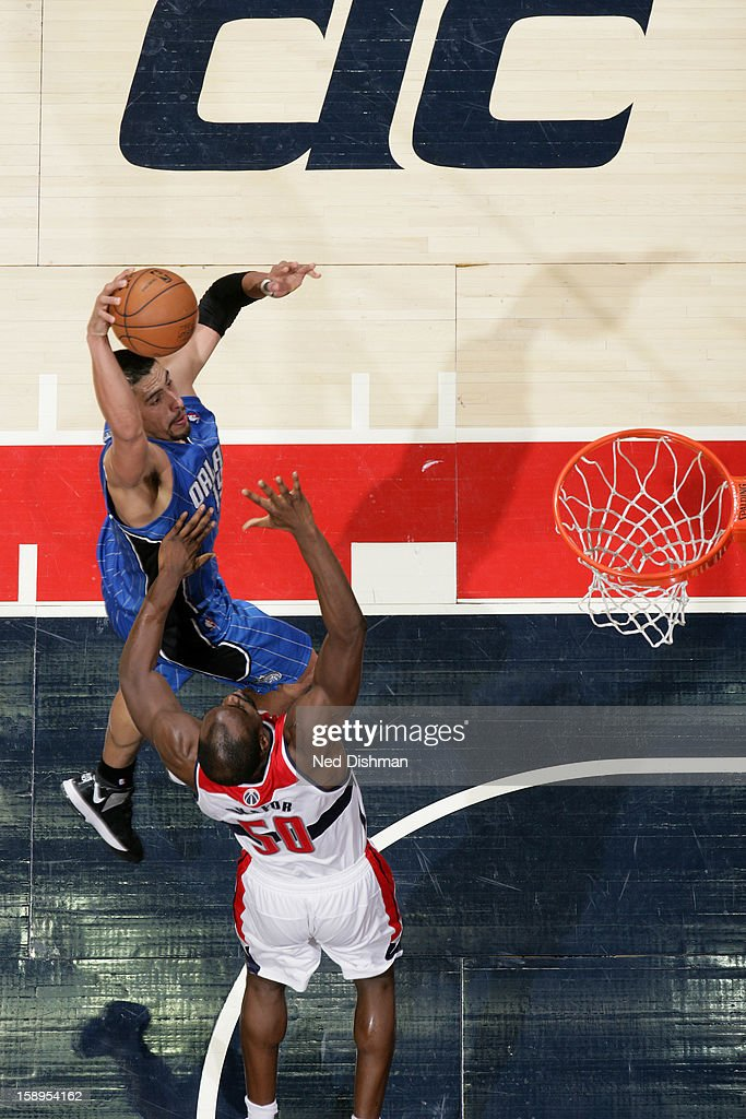 <a gi-track='captionPersonalityLinkClicked' href=/galleries/search?phrase=Gustavo+Ayon&family=editorial&specificpeople=4474343 ng-click='$event.stopPropagation()'>Gustavo Ayon</a> #19 of the Orlando Magic dunks the ball over <a gi-track='captionPersonalityLinkClicked' href=/galleries/search?phrase=Emeka+Okafor&family=editorial&specificpeople=201739 ng-click='$event.stopPropagation()'>Emeka Okafor</a> #50 of the Washington Wizards at the Verizon Center on December 28, 2012 in Washington, DC.