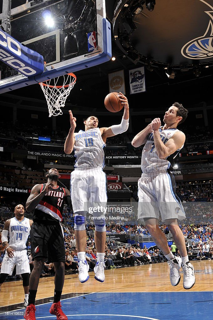 Gustavo Ayon #19 of the Orlando Magic grabs a rebound against the Portland Trail Blazers on February 10, 2013 at Amway Center in Orlando, Florida.
