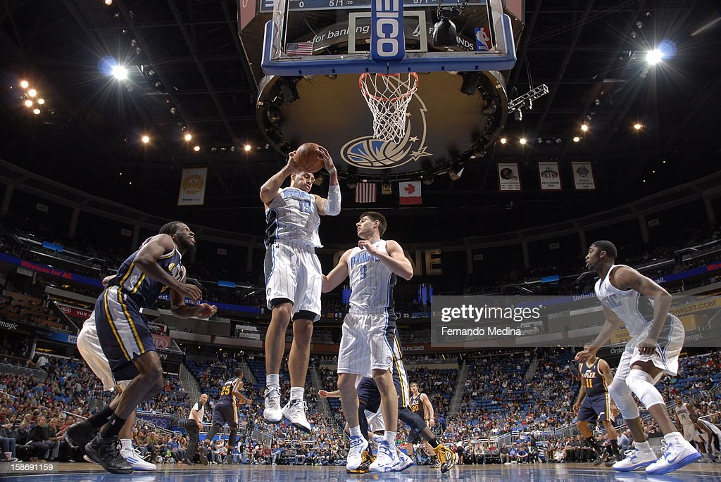<a gi-track='captionPersonalityLinkClicked' href=/galleries/search?phrase=Gustavo+Ayon&family=editorial&specificpeople=4474343 ng-click='$event.stopPropagation()'>Gustavo Ayon</a> #19 of the Orlando Magic grabs a rebound against the Utah Jazz during the game on December 23, 2012 at Amway Center in Orlando, Florida.